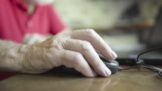 Senior man using wired mouse