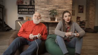 Senior man wins competition in video game in granddaughter