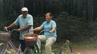Senior people ride bicycles in the park