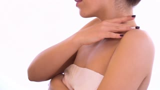 Sensual woman smoothly touches her skin