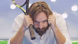 Serious upset tennis player after unsuccessful tennis game
