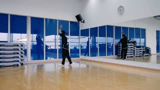 Slowmotion: handsome man training the wushu in the gym