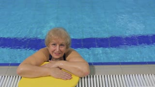 Smiling senior woman in the swimming pool