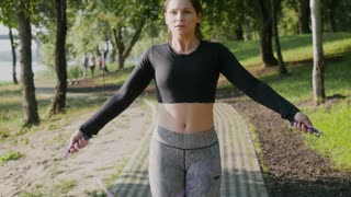 Sports brunette jumping rope