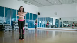 Sporty woman dancing in the dance studio