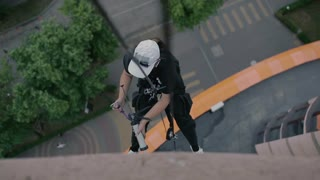 Steeplejack fill the cracks with injector with building material in the building