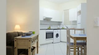 Studio apartment with kitchen transforming into a room