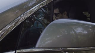 Stylish man in sunglasses get out of the car
