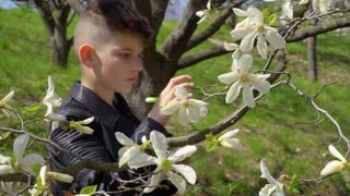 Teenager makes biology laboratory work in the park