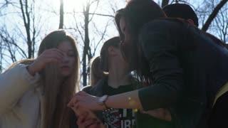 Teenagers looks video on smartphone
