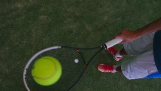 Tennis ball slowly flies up to camera