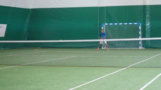 Tennis player warming up before impact on court