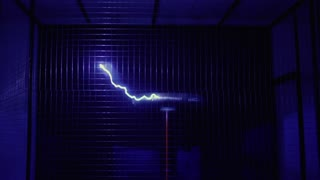 Tesla coil dancing to music in the dark