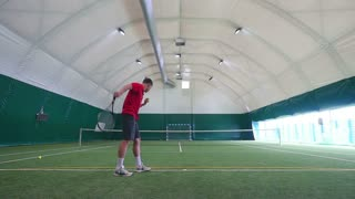 The athlete training on tennis court