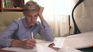 The boy is studying at home