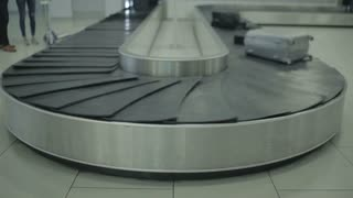 The conveyor belt moving with baggage in the airport