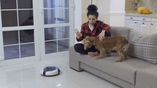The dog scared of vacuum-cleaning robot