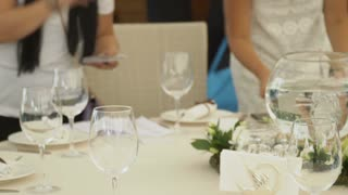 The event managers are engaged in seating of guests in a restaurant