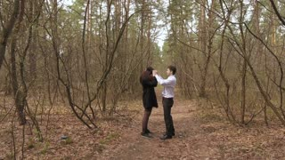 The guy walking with girlfriend in the forest