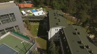 The leisure area with tennis courts, swimming pools and fields for sport games