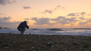 The man photographs the sea sunset
