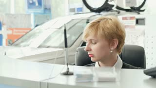 The manager answers the call in car showroom