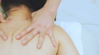 The masseur making a massage to girl