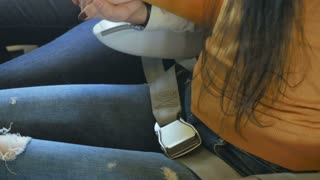 The passenger is fastened with a seat belt in the plane