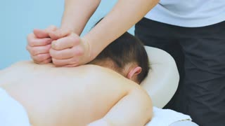 The physiotherapist makes a massage to his patient