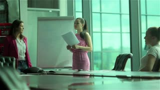 The presentation of businesswoman in business center