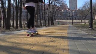 The teenager skateboarding in park