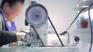 The wheel of the sewing machine is spinning
