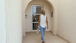 The woman open the door of entrance in the hotel