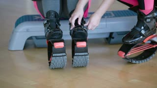 The woman put on the kangoo shoes