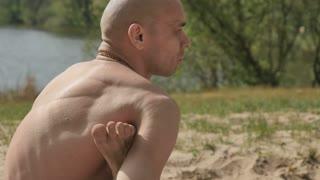The yogi put the leg under the armpit and train flexibility