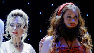 Three beautiful artists sings songs on the stage in theatre