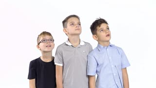 Three boys looks after the plane in sky at white background