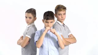Three cool brothers at white background