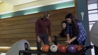 Three friends fights for the bowling balls