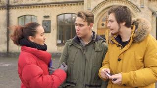 Three friends talks near university