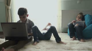 Three little brothers spend leisure time at home