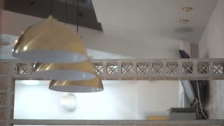 Three modern lamps under the ceiling