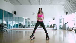 Trainer show the exercise of the flexibility in the dance studio