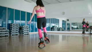Training with kangoo shoes in the dance studio