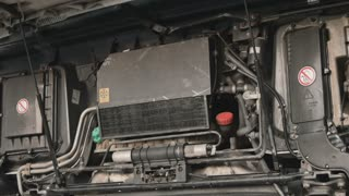 Truck with opening hood