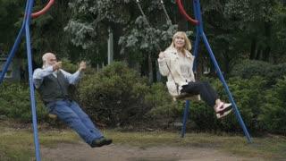 Two adult people swings in slowmotion