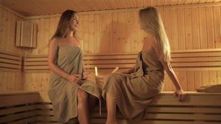 Two girls relaxing in the sauna