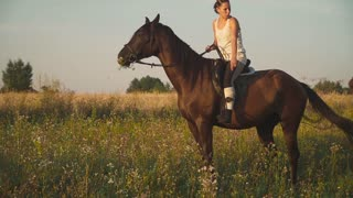 Two girls ride horses