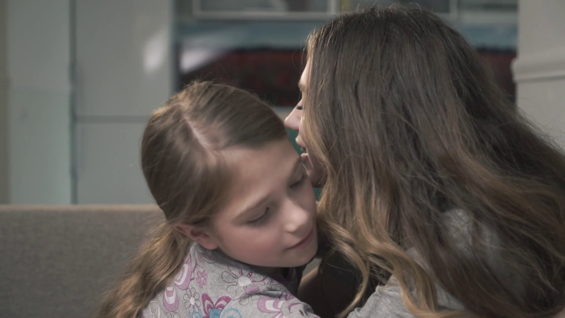 Two sisters cuddle each other close up. Smaller and older girls rub their noses. Sisters relationship Stock Video Footage - Storyblocks