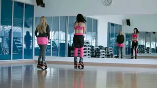 Two sporty girls dancing and jumping with the kangoo shoes